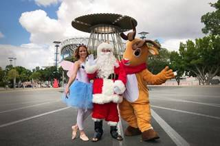 Santa with reindeer and dancer at Olympic Cauldron